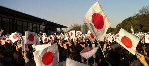 In the crowd at Shinnen Ippan Sanga, the New Year's visit of the public to the imperial palace (2013).